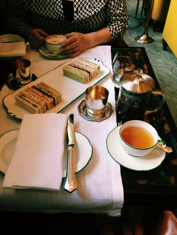 Laid table with tea and sandwiches